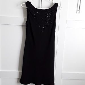 Black dress with sequins on top